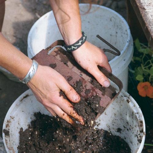 wet mixture into soil block maker