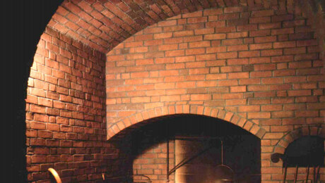 brick arches over fireplace