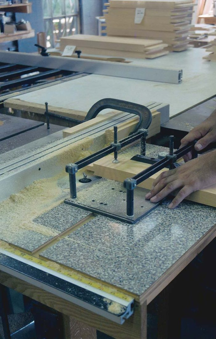 Rails were coped on a router table with a sliding carriage
