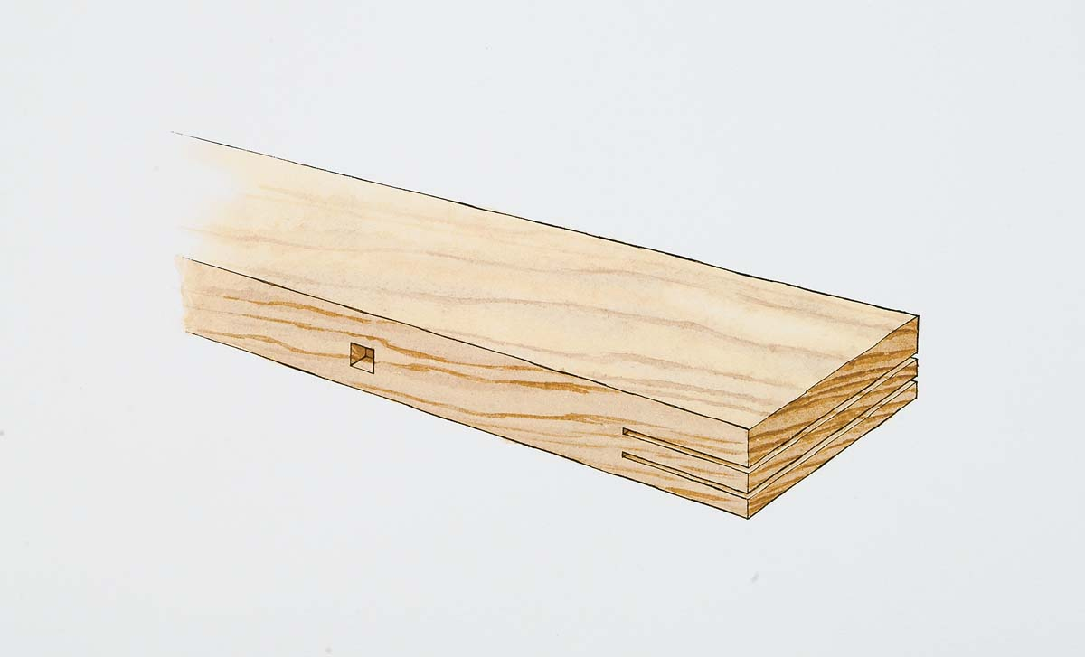 The tenon is cut with two blades mounted on a shaper. The square mortise in the side of the rail was cut previously with a hollow-chisel mortiser.