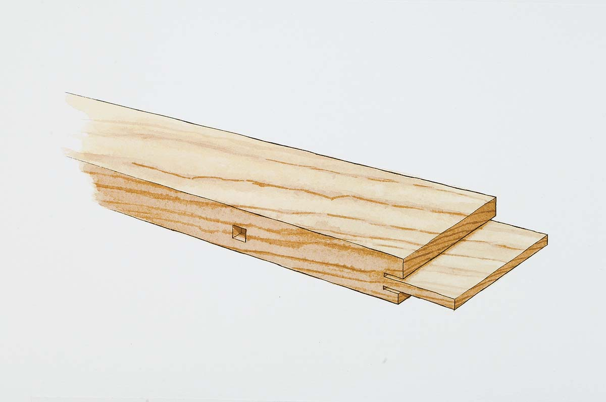 The shoulders are cut with a radial arm saw. Note the difference in shoulder location (a complication resulting from the energy panel's rabbet).