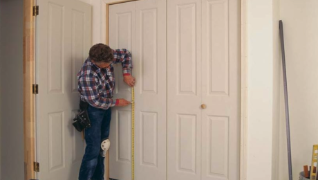 carpenter fitting a bifold door