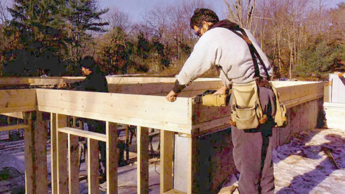 Builder framing a house