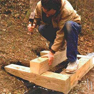 Hammering Galvanized Spikes to Stringer