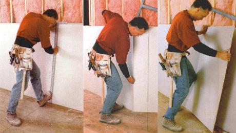 man cutting drywall