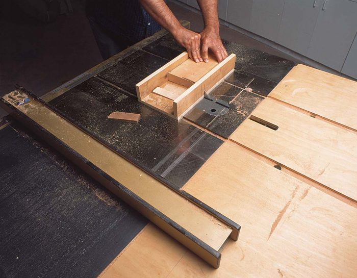 Shop-made sled makes cutting shims fast and safe.