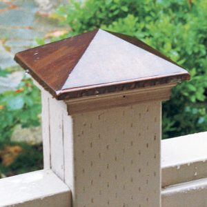 Quick fix for a bad problem. To protect vulnerable end grain, the author covers the tops of 4x4 posts with ready-made copper caps.