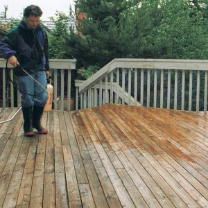 Instant make-over. After the cleaning process has left these old deck boards looking their age, an oxalic-acid based wood brightener quickly restores their youthful sparkle. The brightener is allowed to stand for 20 minutes, then is rinsed off with the pressure washer.