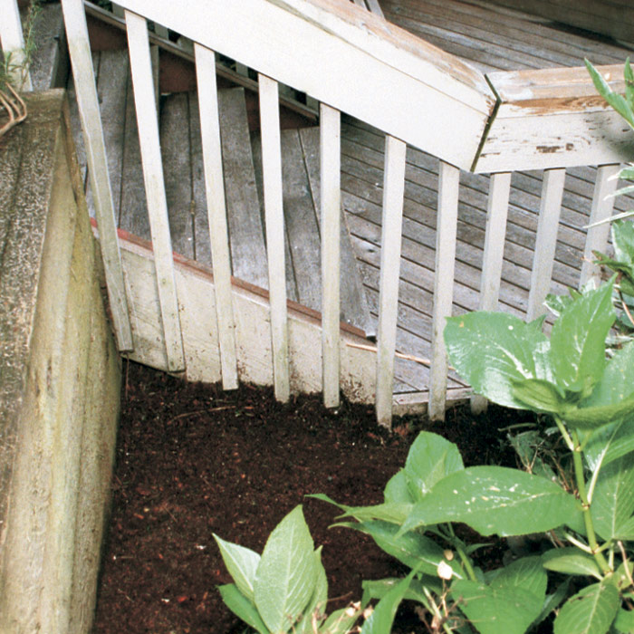 4. Place a barrier between mulch and ground-level framing.