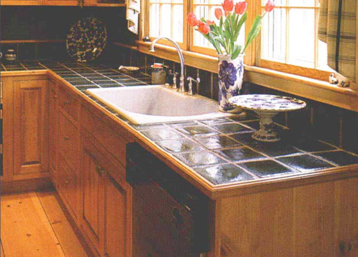 ... Author Summarizes The Pros And Cons Of A Variety Of Materials Used For  Kitchen Countertops, From Wood Butcher Block And Concrete To Tile, Solid  Surface, ...