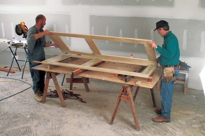 Marrying the frames. With the inner layer glued and tacked, the second frame is placed atop the first.