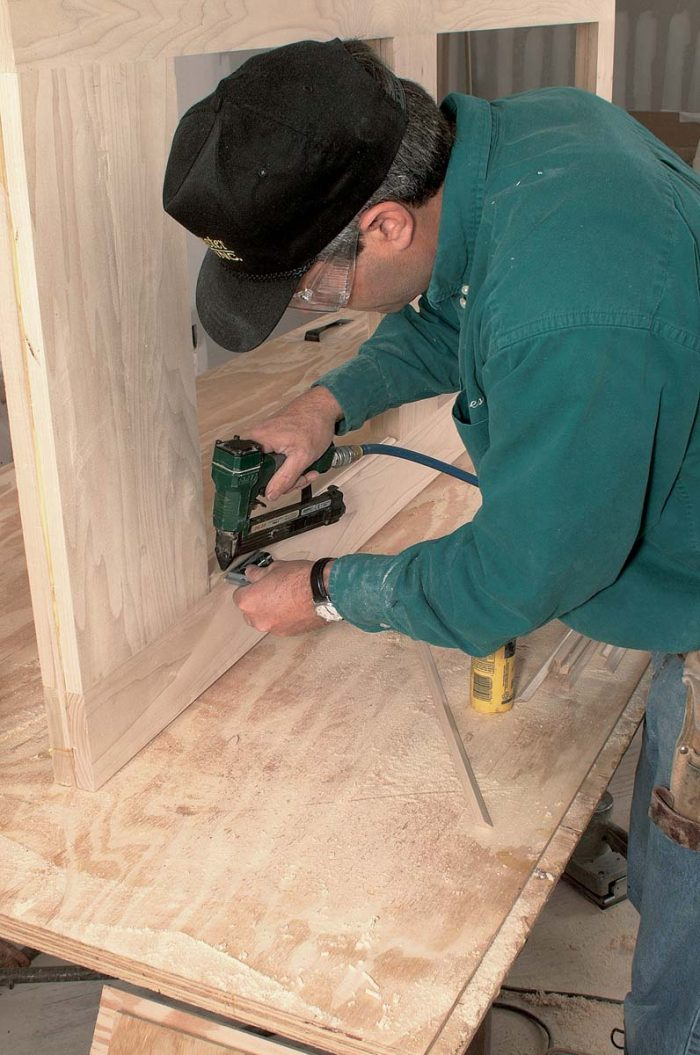An applied quarter-round molding holds the panels in place.