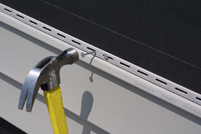 Hammer and a nail in panel slot