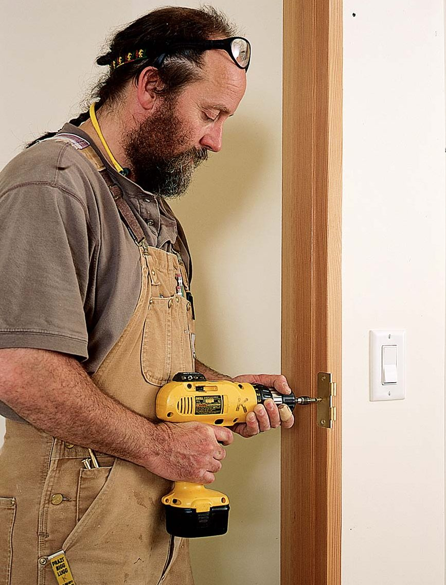 When the plasterer was finished, the author installed the hinges on the door jamb and doors before the final fit.