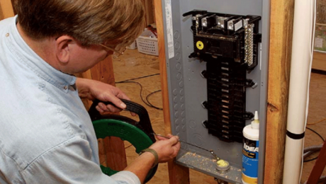 person working on a subpanel