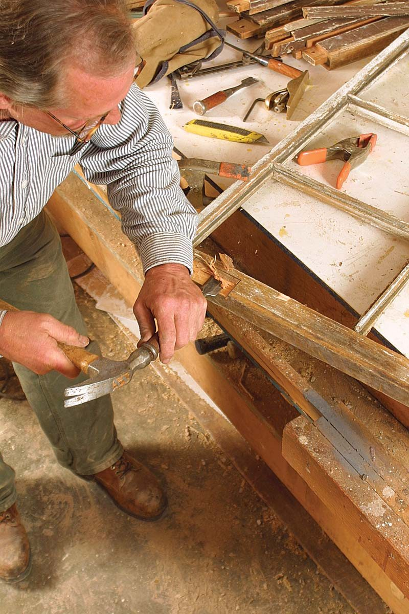 Deep gouges and rot are carved out and squared up with a chisel to make room