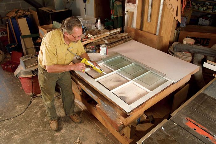 the author beds each pane of glass in a layer of acrylic latex caulk
