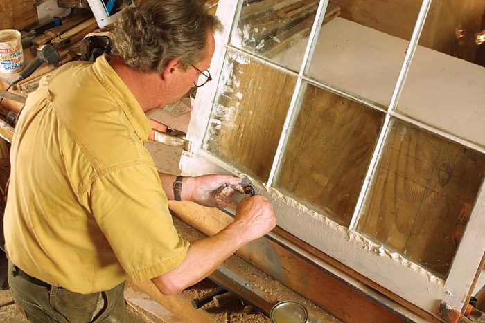 After lubricating a putty knife with boiled linseed oil, he tools the glazing compound using an index finger as a guide. Finally, he eliminates minor imperfections in the glazing by wiping downward with a taping knife.