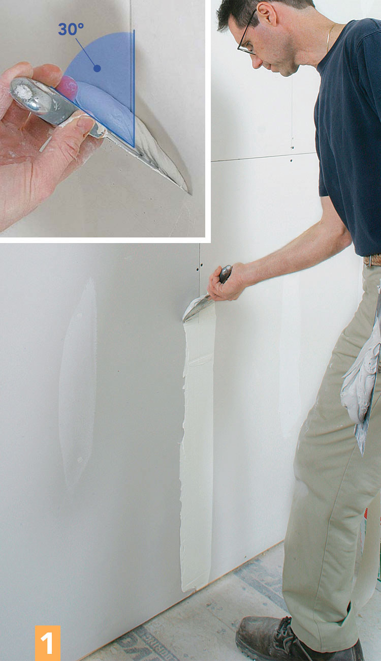 spreading drywall compound