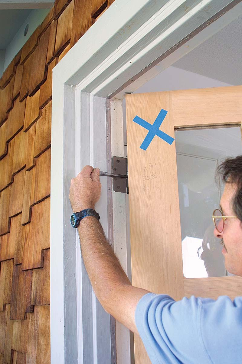 o move the door toward the strike jamb, place a nail set between the hinge leaves and against the hinge barrel, then close the door gently.The nail set spreads the hinge slightly.