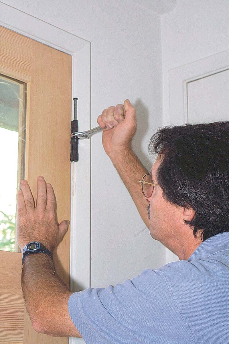 to move the door toward the hinge jamb, first pop up the hinge pin until it's just engaging the top barrel.