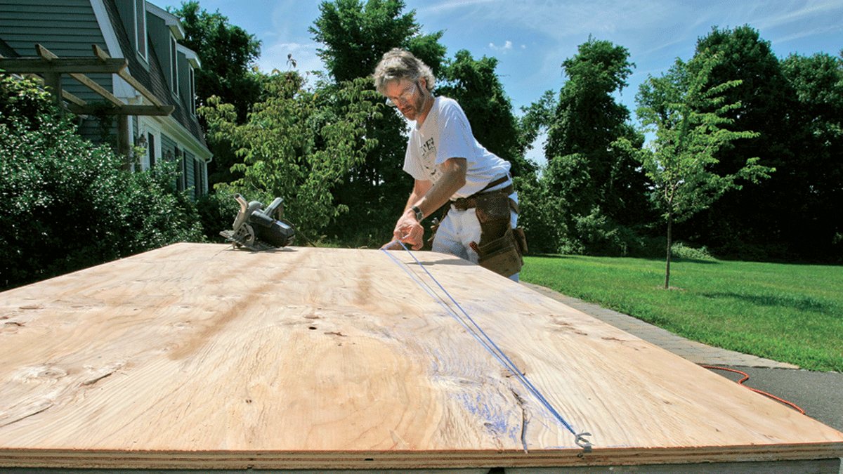 person cutting plywood