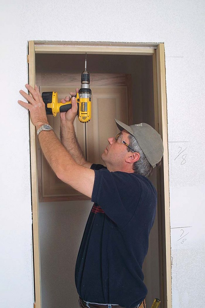 Install head jambs with screws so that jambs can be removed to access the roller-adjustment mechanism.