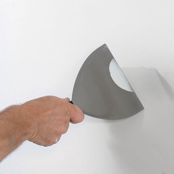 Essential patching tools. Use a 6-in. taping knife and a 5-in-1 tool for wall prep