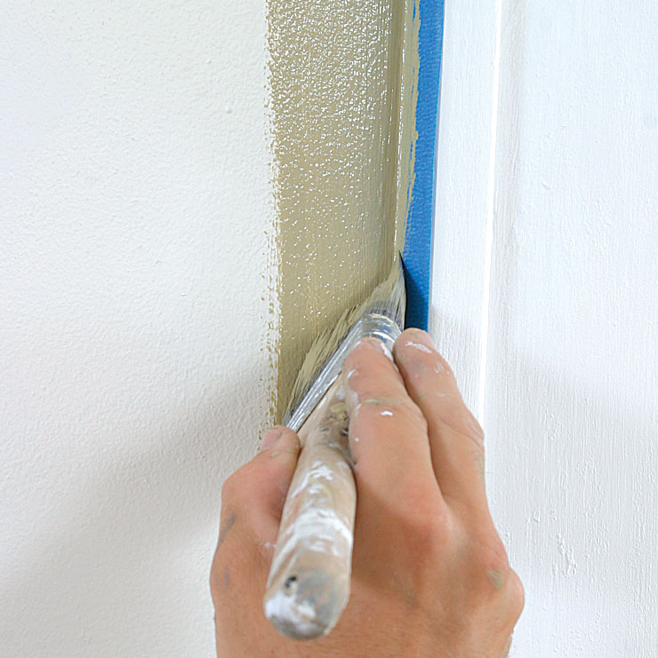 Use tape. Pros rely on a steady stroke to avoid using masking tape in many situations.
