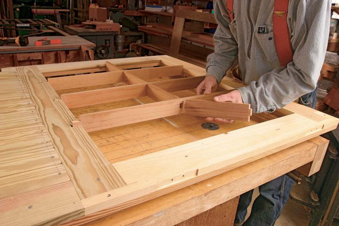 Tenon shoulders for the muntin assembly are cut on a tablesaw;