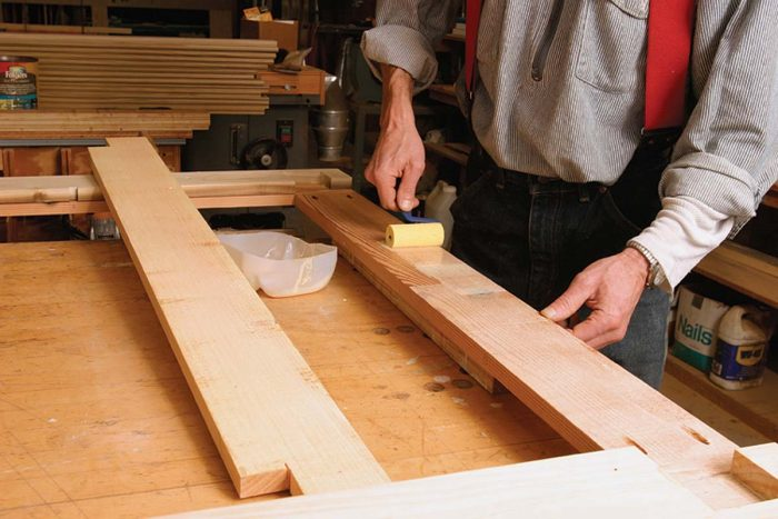 Notched connections in the middle layer turn into mortise-and-tenon joints when outer layers are glued in place.