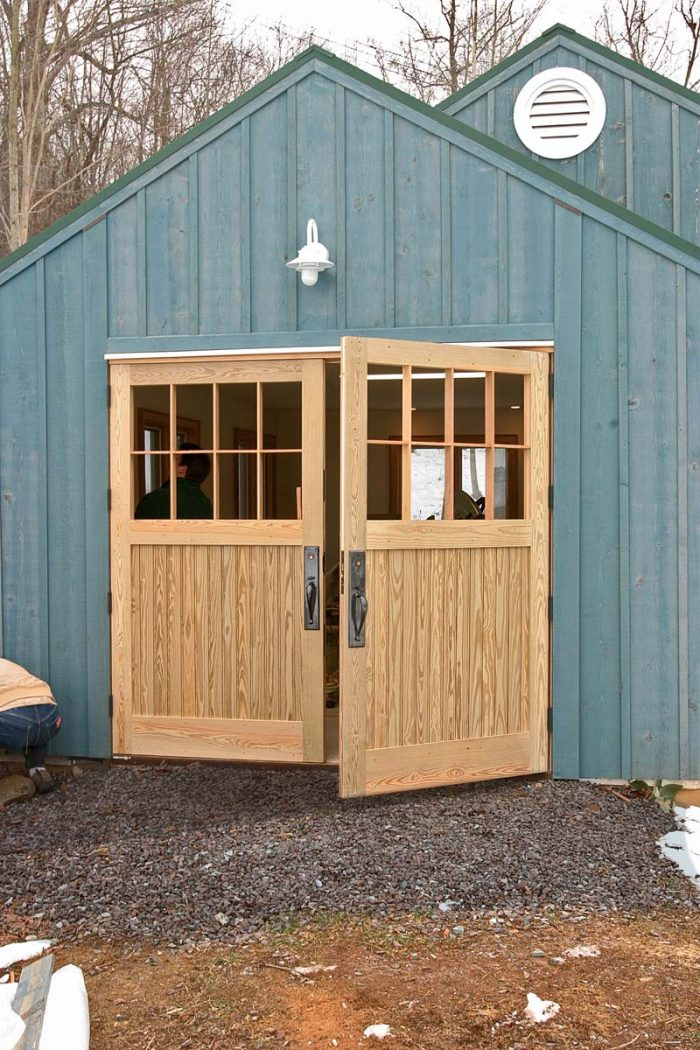 A perfect fit. The doors were made 1⁄4 in. oversize, then planed to fit the opening. Four hinges support each door.