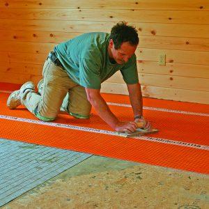 wooden float to bond mortar to tile a big floor