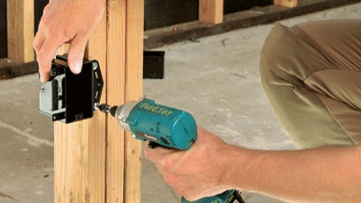 person drilling and installing new receptacle