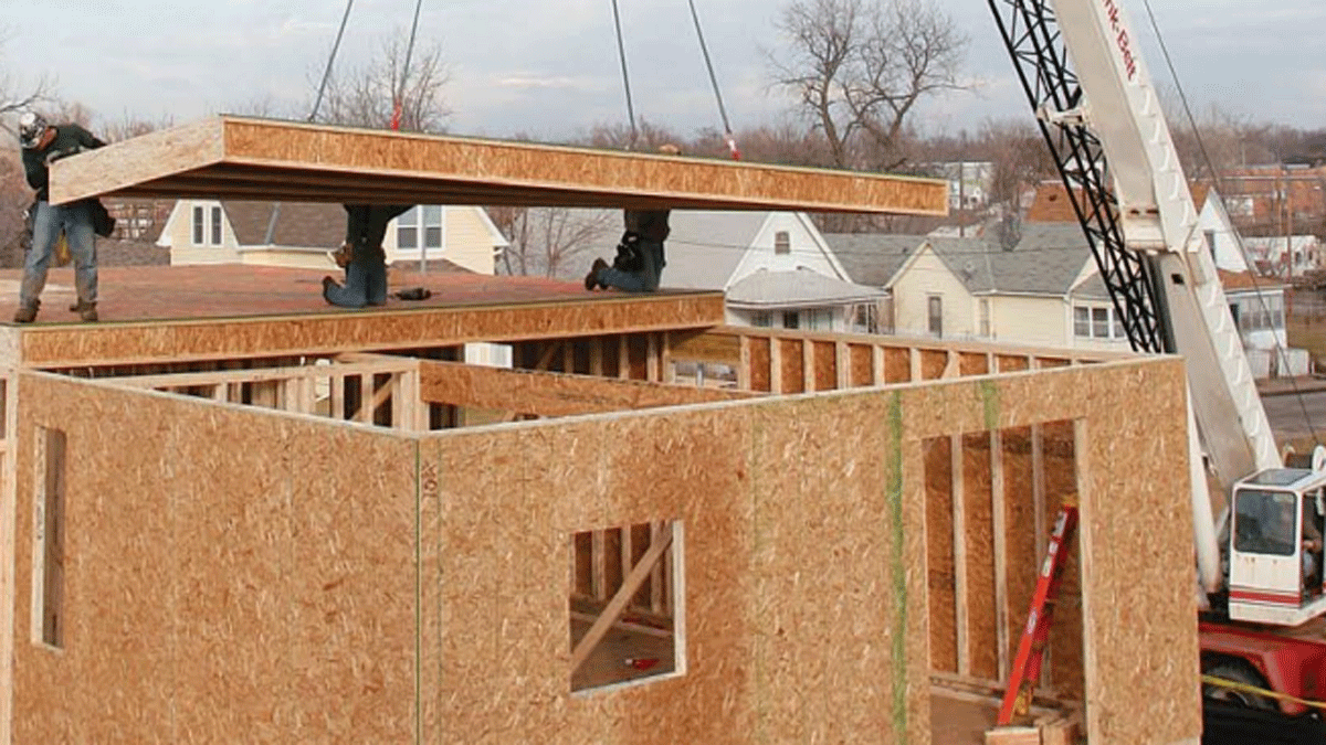 factory framed floor being placed