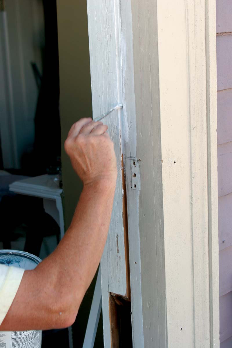 I sand the jambs smooth, then prime and paint them to create a tough, slippery surface.