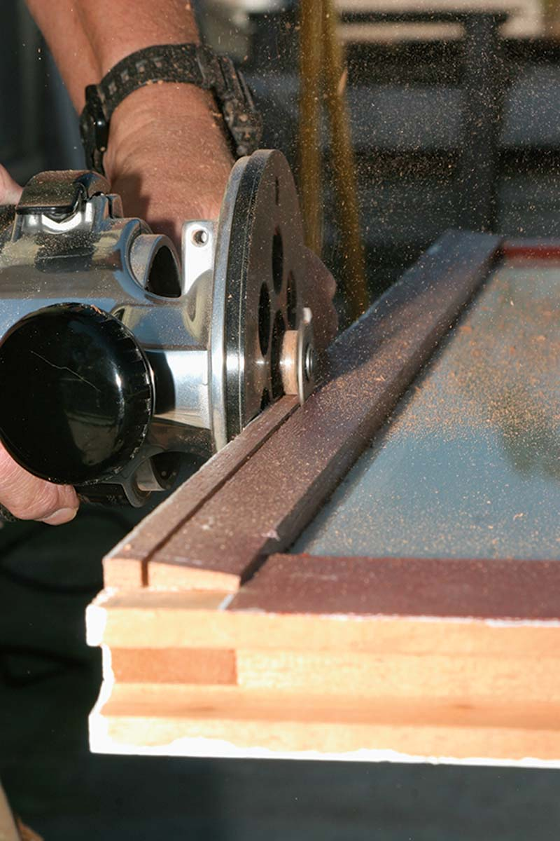 Cut a groove along the meeting rail of the lower sash using a slot-cutting bit in a router.