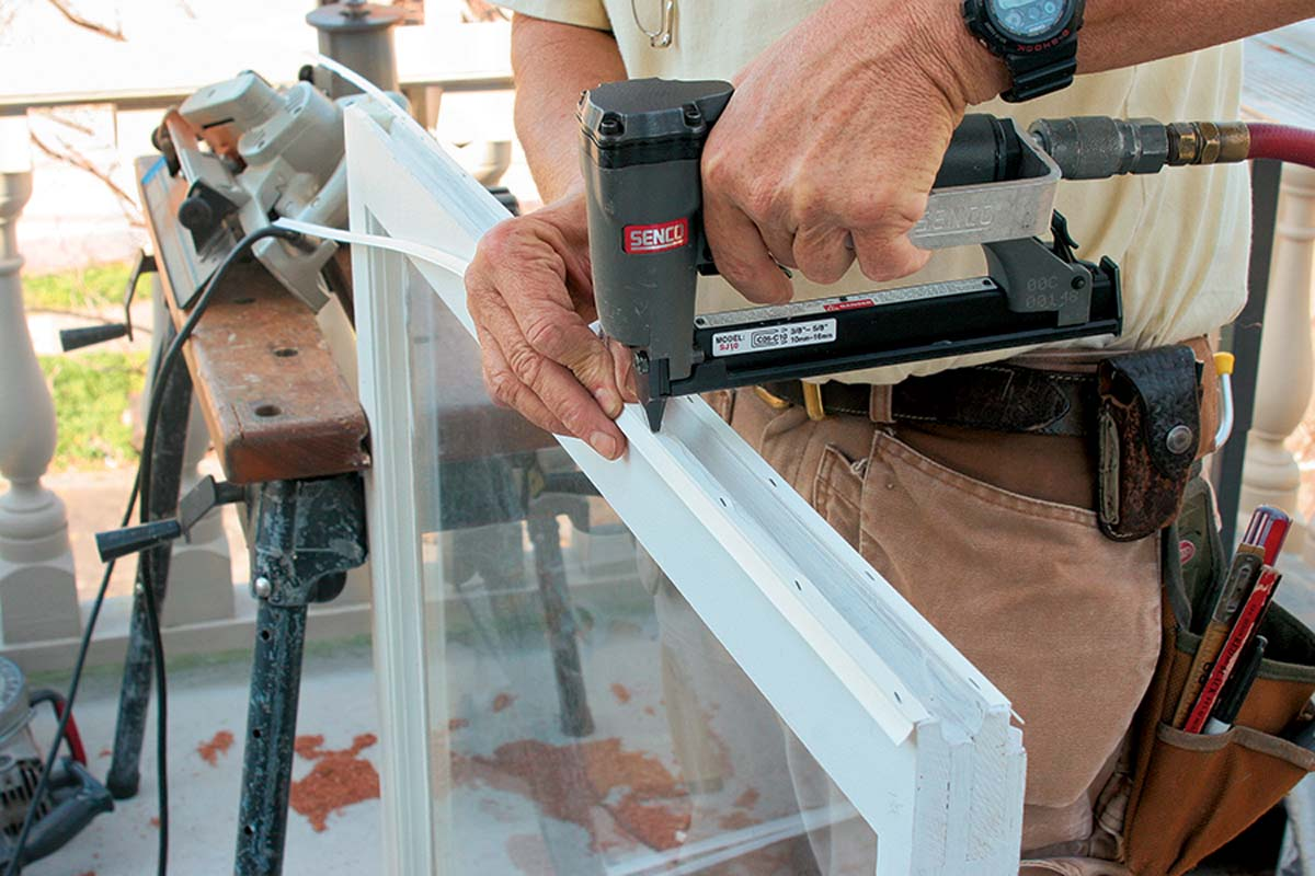 """cut the mounting """"arrow"""" off the seal and attached it to the sash with stainless-steel staples."""