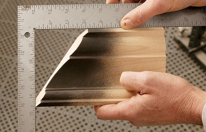 To check the cut, measure the length of the miter