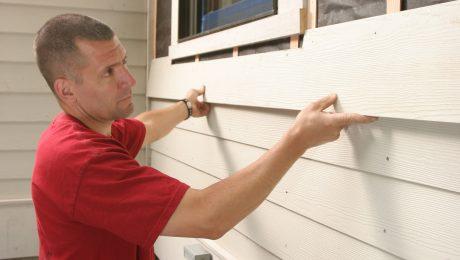 Man installing exterior siding