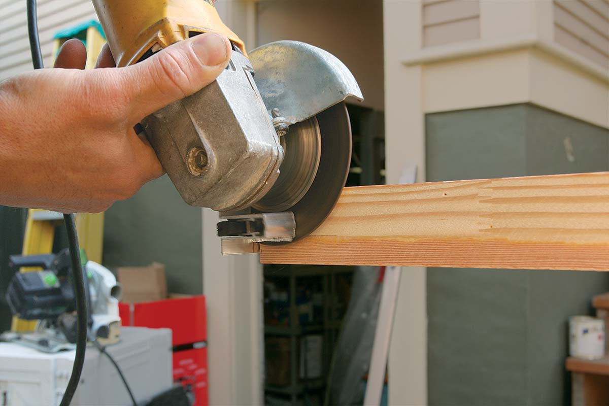 I move the scribe line clear of the door's edge and cut the entire mechanism to length with an abrasive grinding blade (a fine-toothed hacksaw will work as well).