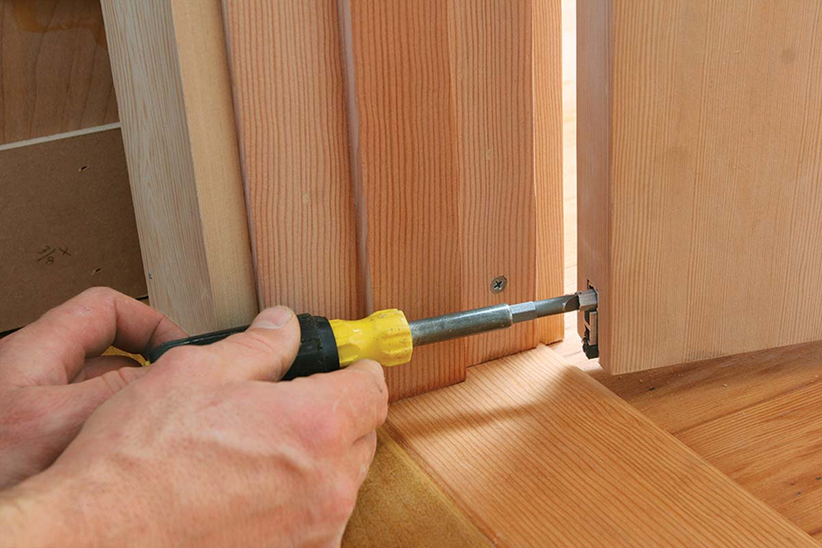 A screw driven flush to the door jamb contacts the pin and prevents it from creating a depression in the wooden jamb.