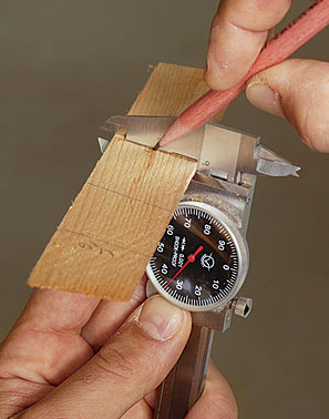 use a set of dial calipers; all I have to do is lock the jaws at the desired thickness, shove in the shim until it is snug, and mark it