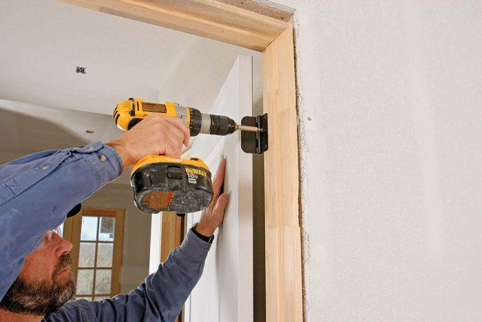 screwing into door frame