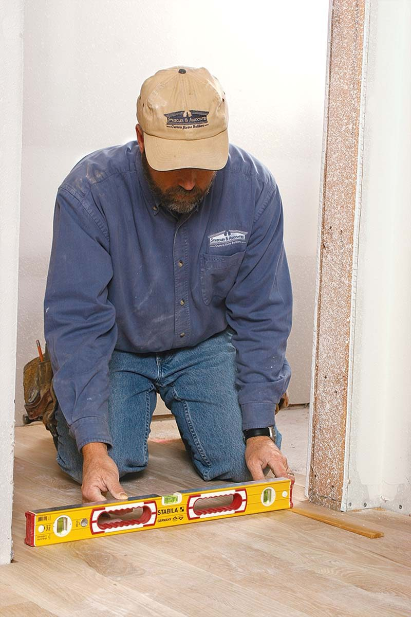 Using a level and a shim, determine the difference in height (if any) across the width of the opening.
