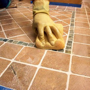 Make sure to wring out the sponge thoroughly before scrubbing.