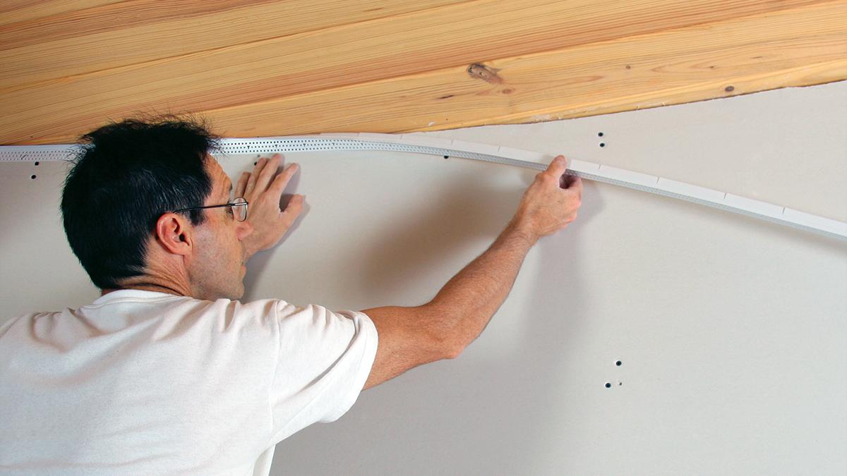 where drywall meets wood