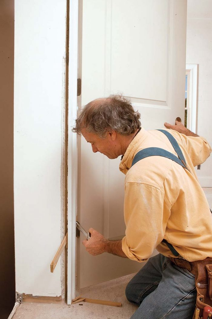 insert an adjustable wrench or something of a similar size between the hinge leaves, then slowly close the door.