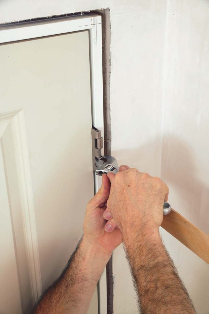 The door doesn't close properly because the hinges are binding or because the hinge-side gap is too big.