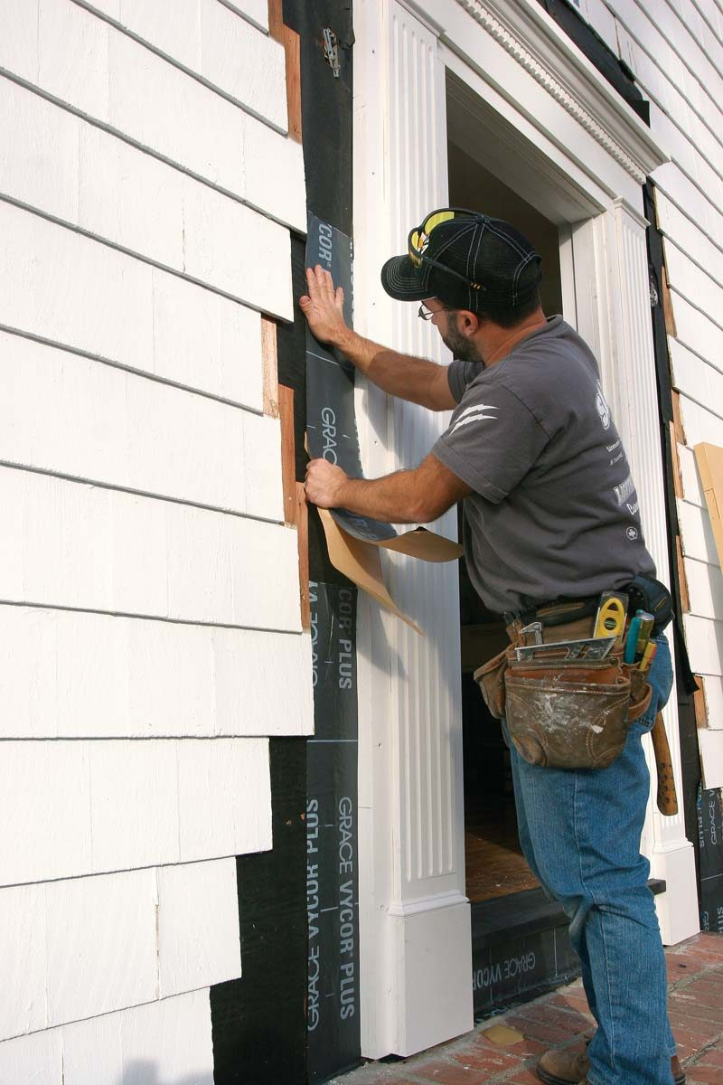 Flexible flashing lapped up and around the door seals the joint between the housewrap and the back-flashing.